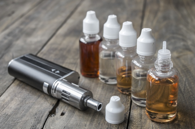 e-cigarettes with different re-fill bottles, close up